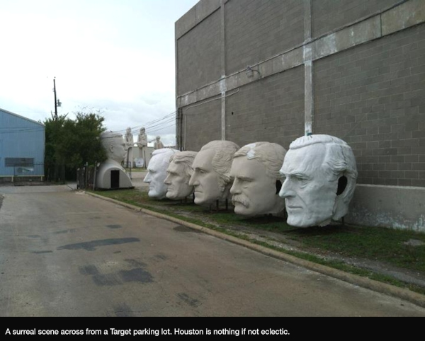 Statue heads across from a Target parking lot in Houston