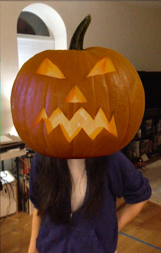 A pumpkin-head virtual mask