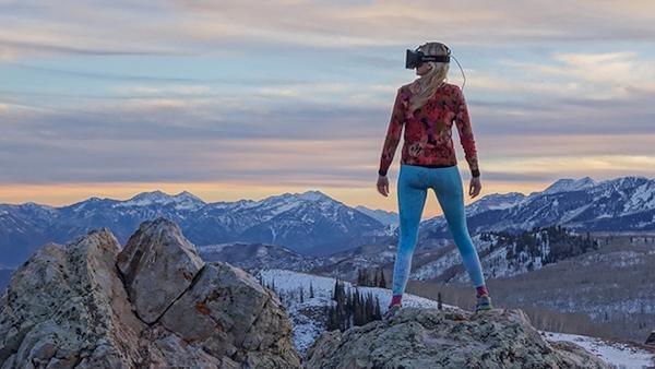 Woman wearing Oculus Rift in nature scene