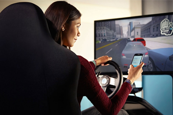 A woman in AT&T's It Can Wait texting-and-driving simulation