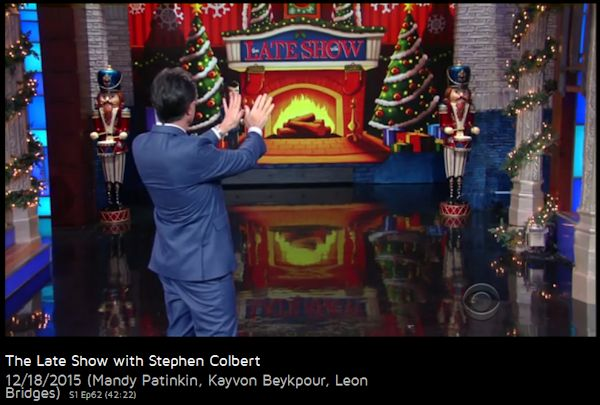 Stephen Colbert warming hands with virtual fire