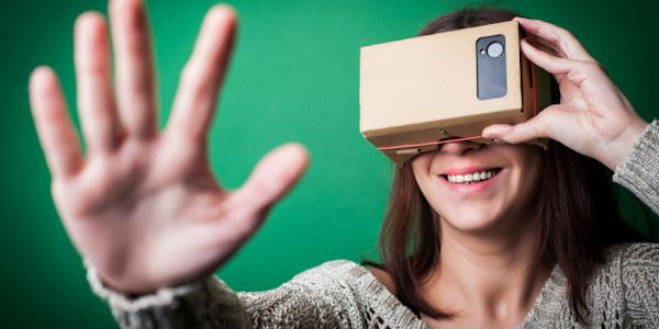 Woman using cardboard VR headset