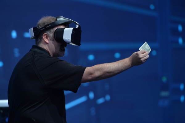 Intel Project Alloy - man holds dollar bill and sees it through headset