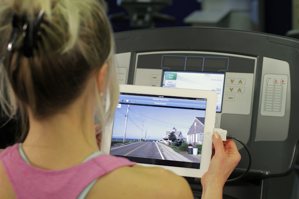 Outside Interactive - woman on treadmill with iPad