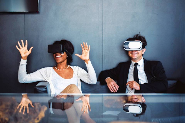 Woman and man wearing VR headsets