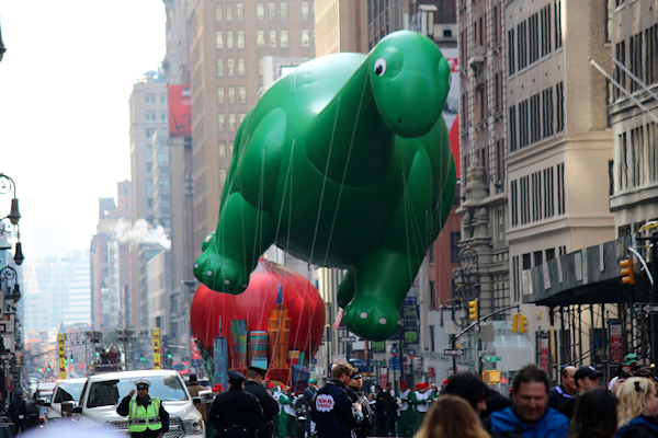 Macy's Thanksgiving Day parade (float above crowd)